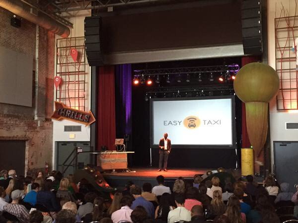 Board Chairman Mr. Bankole Cardoso on stage at SwitchPoint 2015 speaking about leapfrogging for health and DRASA