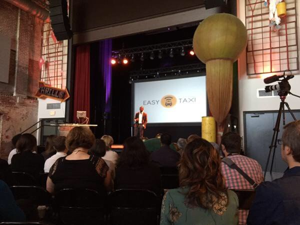 Board Chairman Mr. Bankole Cardoso on stage at SwitchPoint speaking about leapfrogging for health and DRASA