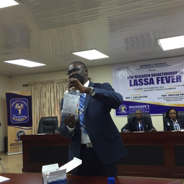 Dr. Christian Happi, Director, African Center of Excellence for Genomics of Infectious Diseases (ACEGID) holding the Pan-Lassa fever rapid diagnostic kit