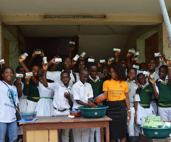 DRASA, Unilever, and students (notice we're still washing hands even as we smile for the camera)