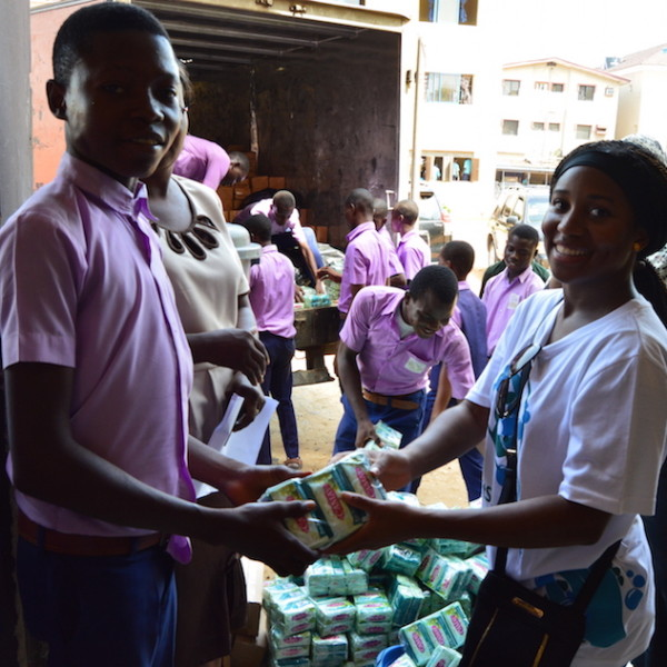 Distributing Unilever soap, roll-on deodorant, and lotion to students