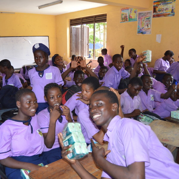 Happy students with their Unilever soap, roll-on deodorant, and lotion