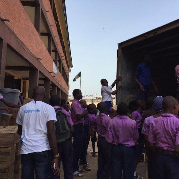 Offloading the truck full of goodies for the students and staff