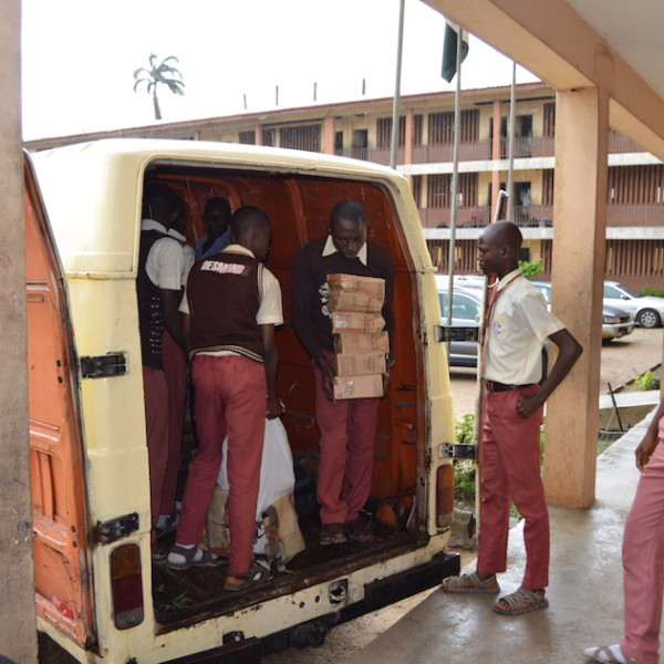 Students unloading the truck carrying donated products from Unilever Nigeria