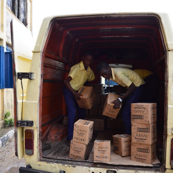 Students unloading the products donated from Unilever Nigeria