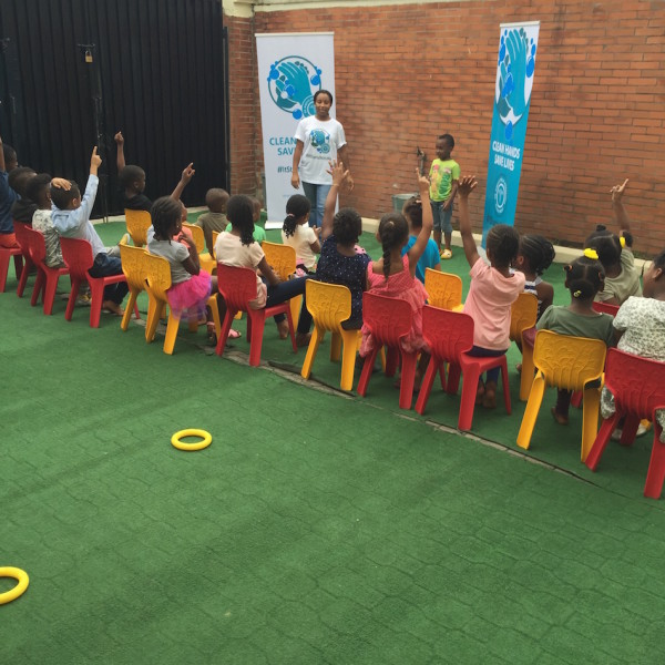 Speaking to the children and asking them about handwashing