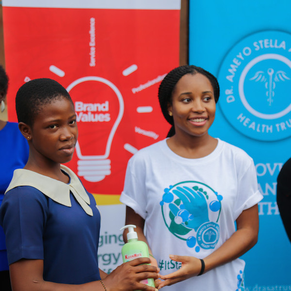 DRASA's MD giving away the donated Kleanmate soap to a student