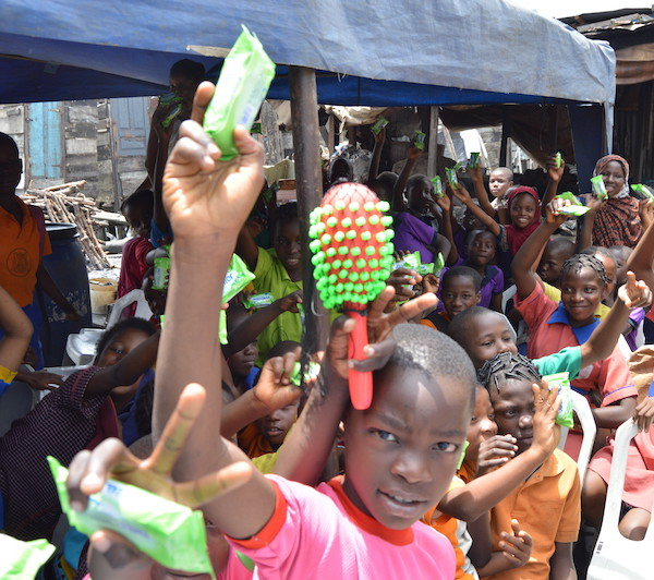 Children receiving their soap