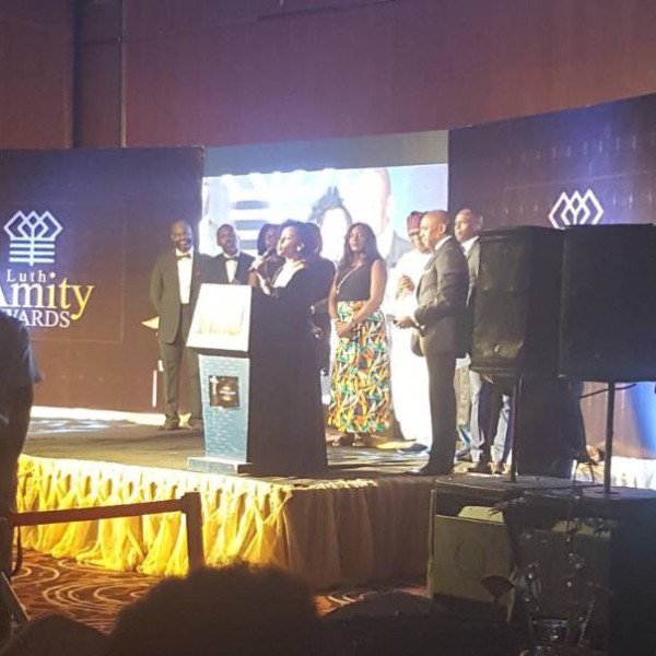 DRASA MD Niniola Soleye accepting Dr. Adadevoh's Lifetime Achievement Award