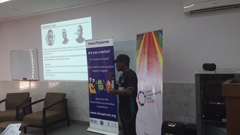 One of the semi-finalists pitching his team's innovative sanitizer dispenser for the #HackTheGerms competition