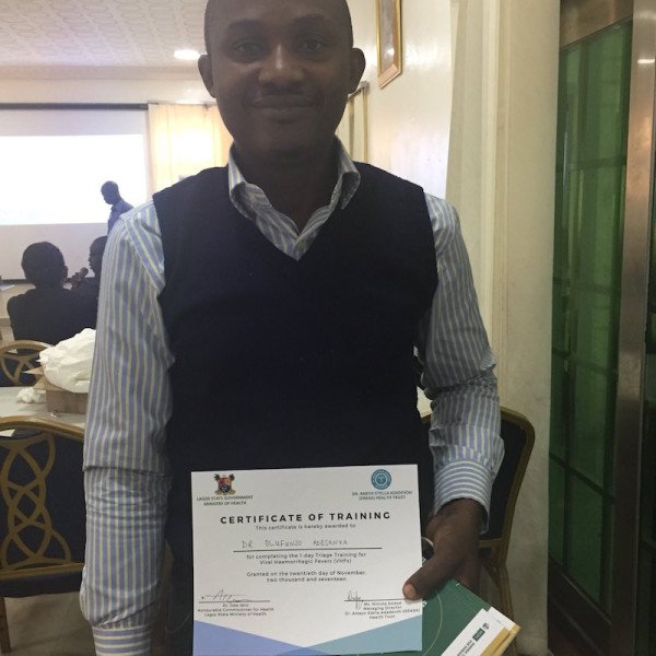 One of the training participants Dr. Olufunso Adesanya with his certificate of completion signed by Honourable Commissioner for Health and DRASA