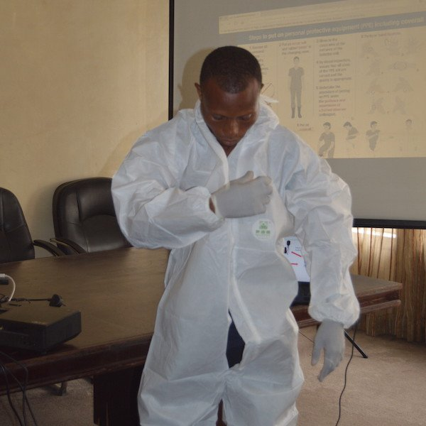 Putting on personal protective equipment (PPE)