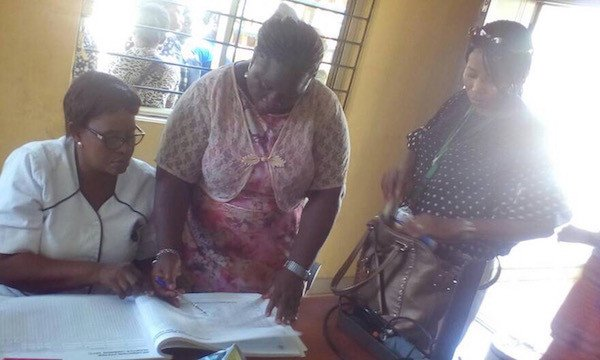 Lagos State Ministry of Health Surveillance Team checking records at one of the simulation sites (a health facility)