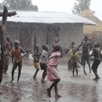 Ronke and friends playing in the rain