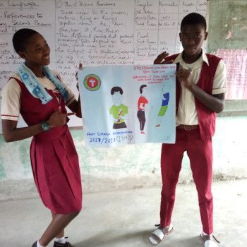 Youth Ambassadors presenting their Health and Hygiene signage to help them teach others what they have learned
