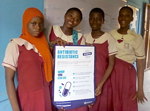 DRASA Youth Ambassadors with a poster on antibiotic resistance from the World Health Organization (WHO)