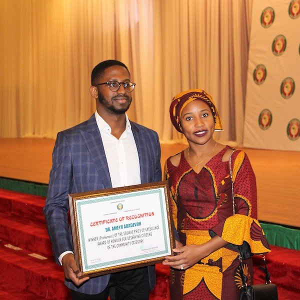 Bankole Cardoso and Niniola Soleye accepting the posthumous Economic Community of West African States (ECOWAS) Award of Excellence for Dr. Ameyo Stella Adadevoh