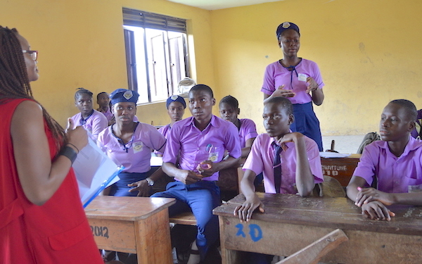 Our Youth Ambassador Fathia (standing) asking a question during one of the DRASA Health and Hygiene Club meetings in her school