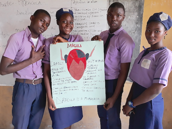 Fathia Motunrayo Alade (second from left) with 3 of her fellow DRASA Ambassadors presenting the supergerm character they created: Dracula