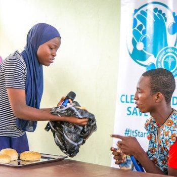 The bread seller serving her customer Mr. Obi