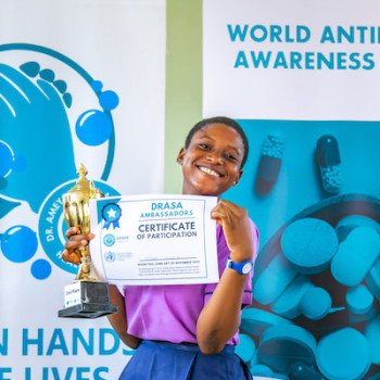 DRASA Ambassador with her Certificate of Participation and trophy