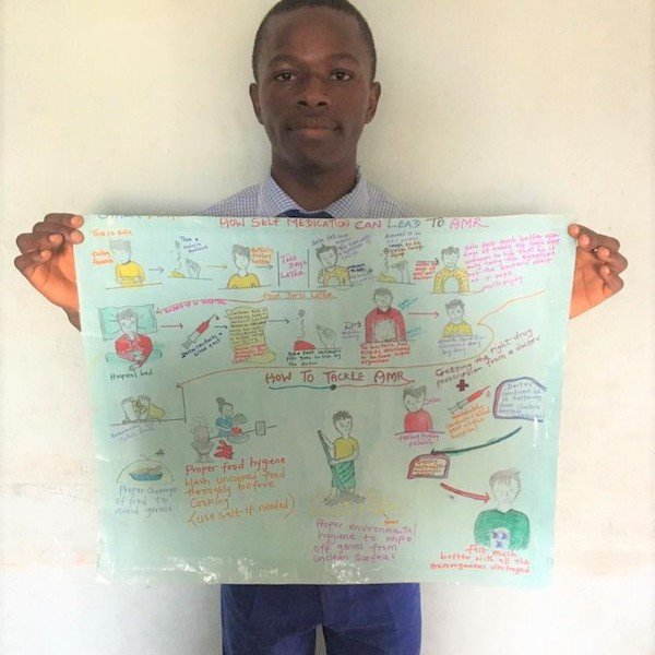 One of the winning students with his poster